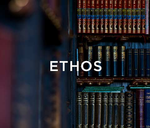 a bookcase with books and text saying ethos