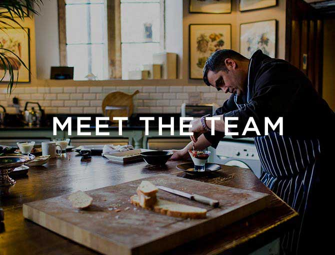 meet the team text over an image of the chef in the kitchen