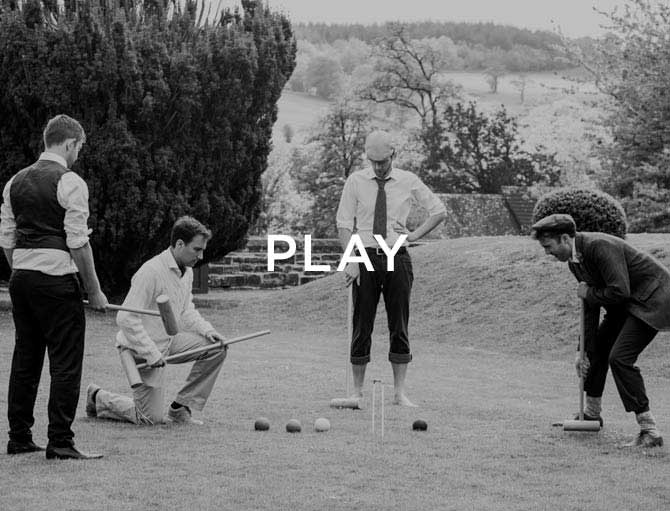 four men playing croquet on the lawn and the text Play