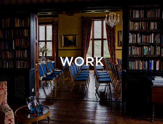 Room with books and chairs in a row with text saying work