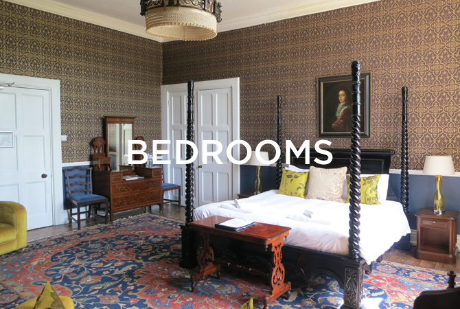 Huntsham Court bedroom with four poster bed and bedrooms text