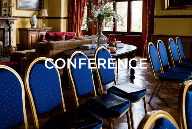 blue conference chairs with conference text