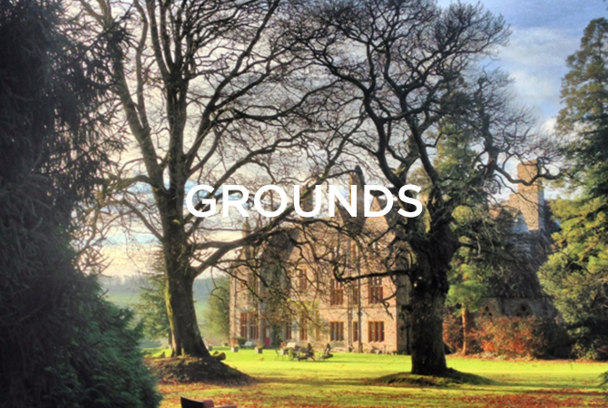 outside shot of Huntsham manor in the sun with grounds text