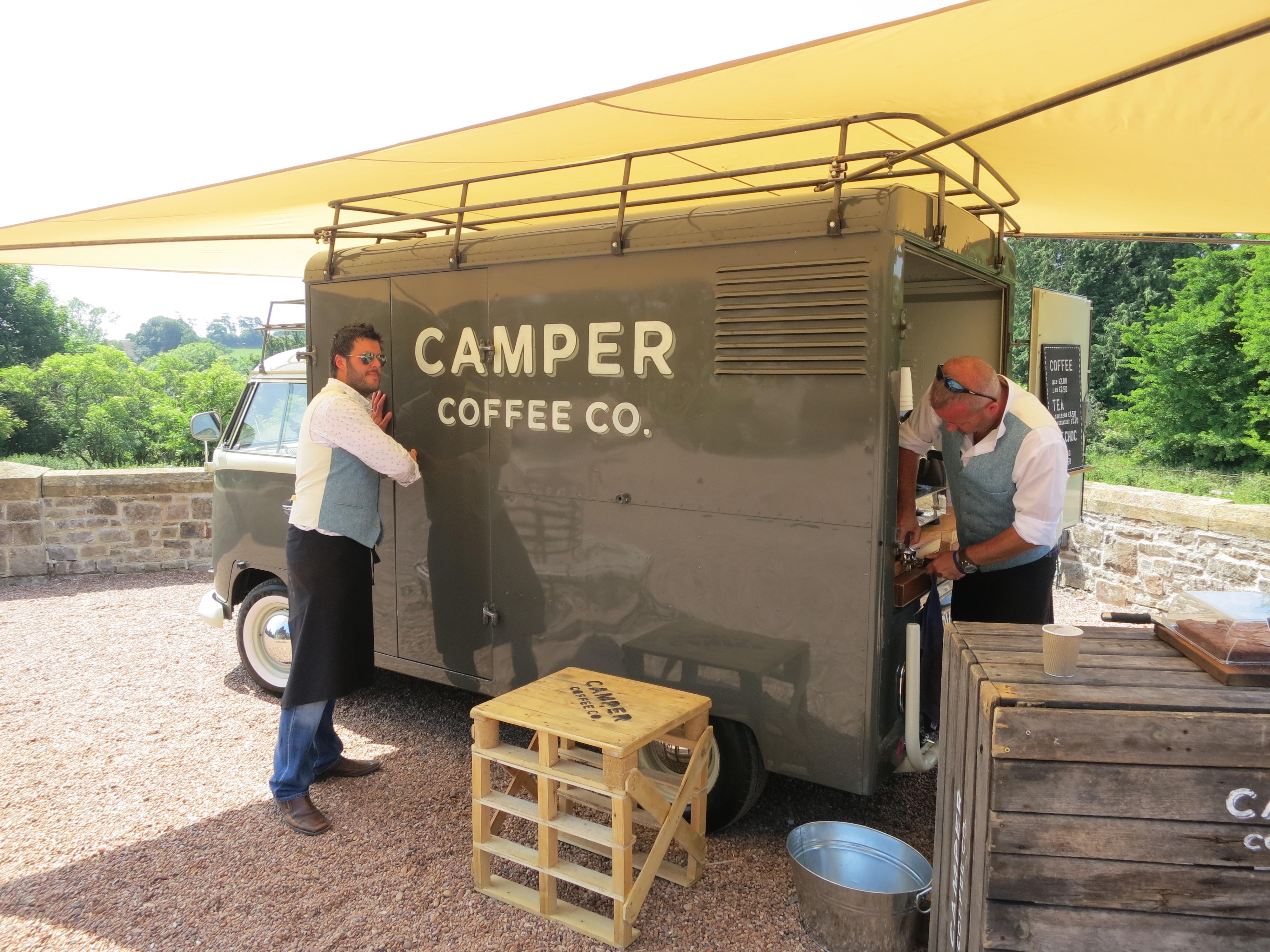 camper coffee team setting up their van