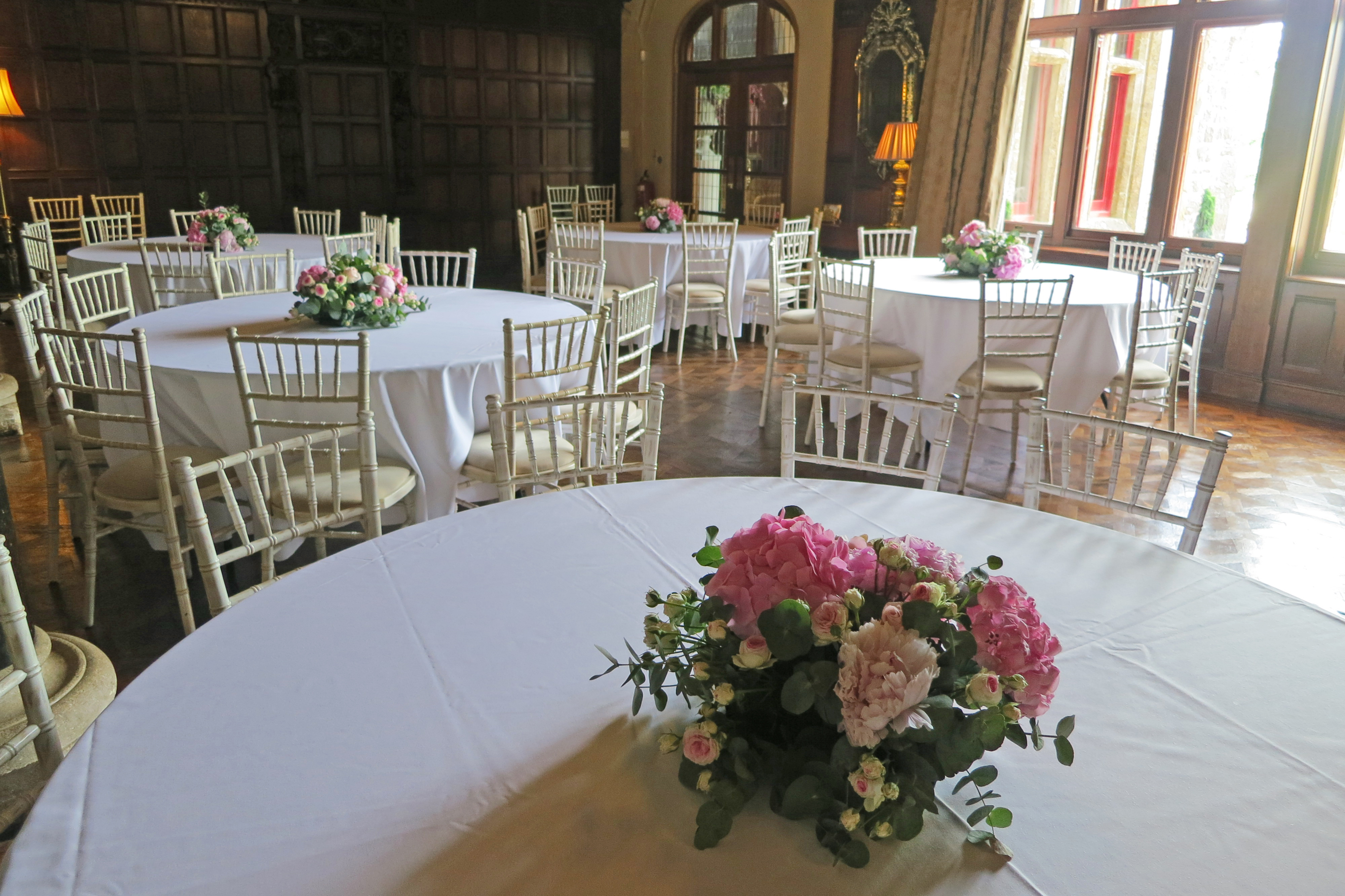 white dining tables and chairs with flowers