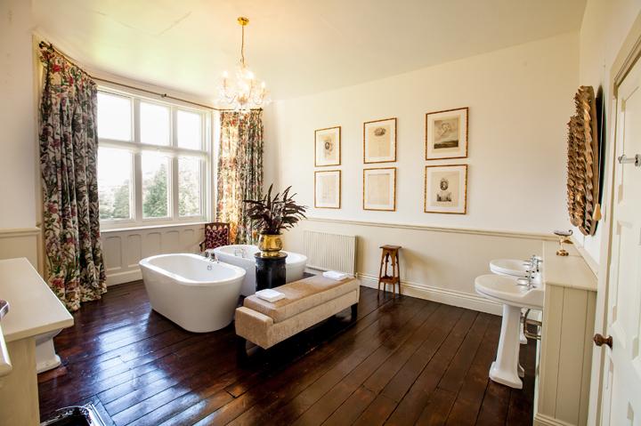 a bathroom with double bath